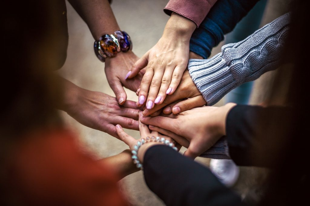 Group of hands in a circle